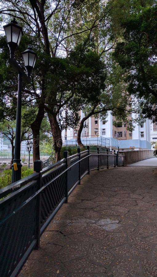 Serenity pathway to a building in Tsuen Wan stock images