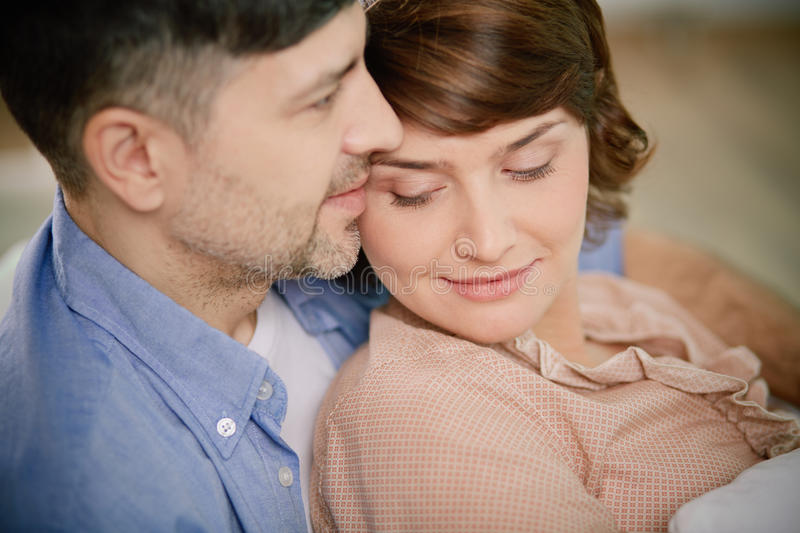 Serenity. Portrait of serene couple enjoying being together stock images