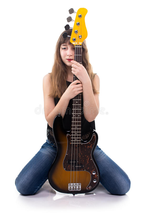 Serenity teenager hugging bass guitar stock image