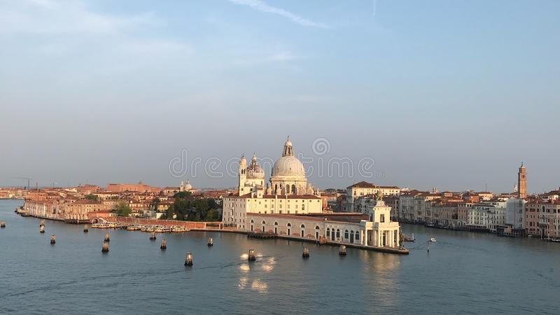 The Serenity of Venice, Italy. Evening nears and sets it beautiful light on Venice and it's architecture stock image