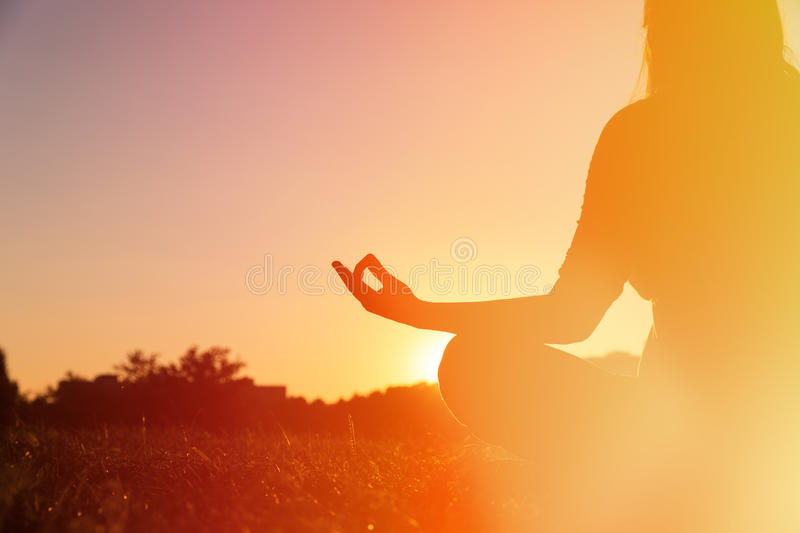 Serenity and yoga practice at sunset royalty free stock images