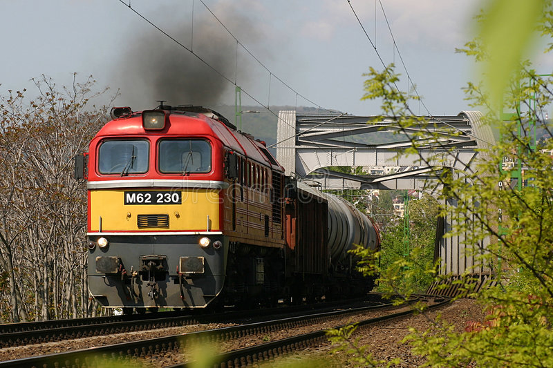 Sergei with freight train. Hungary's most powerful diesel engine (type M62 Sergei) hauling a freight train in Budapest stock photos
