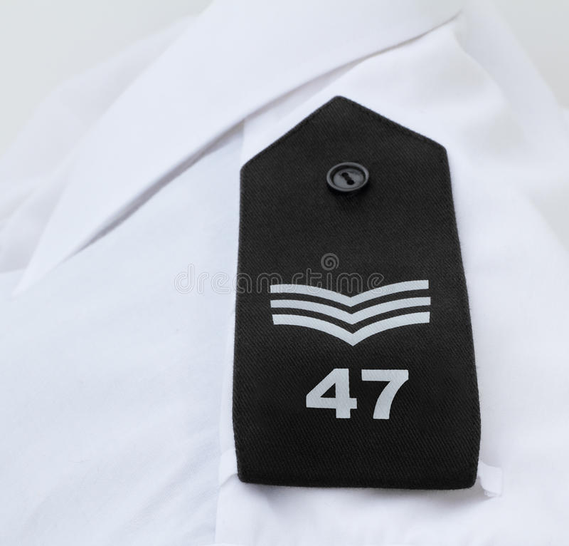 Sergente di polizia britannico bande/Epaulettes immagini stock