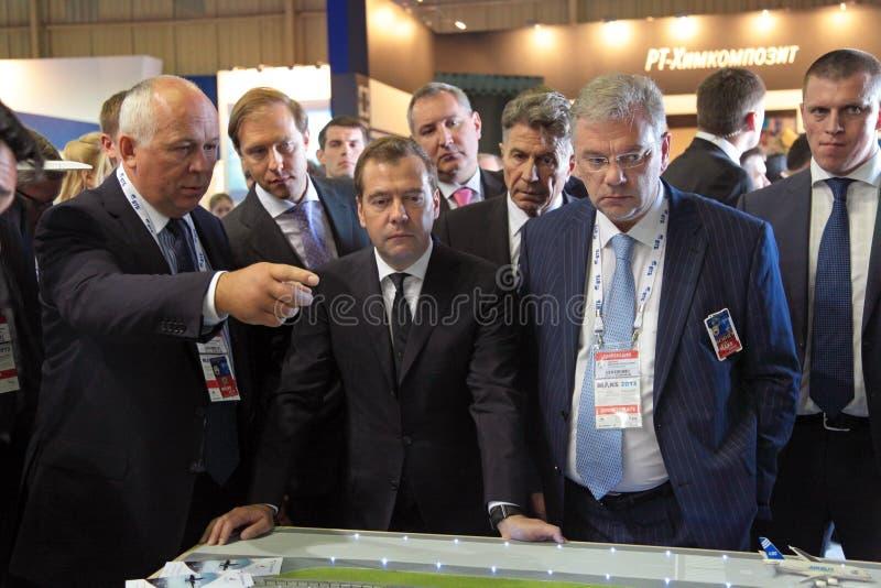 Sergey Chemezov, Dmitry Medvedev y Dmitry Shugae fotografía de archivo