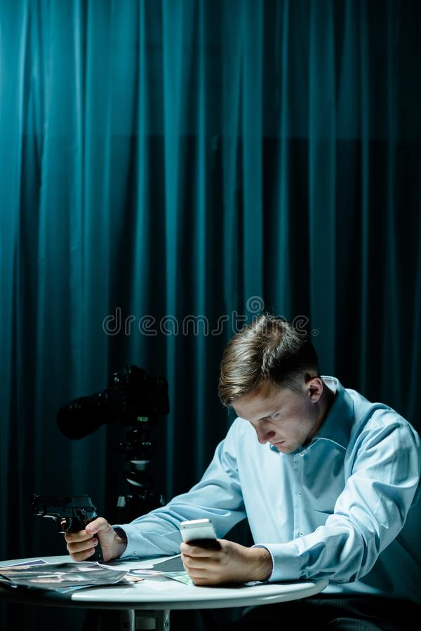 Serial killer in dark room stock photography