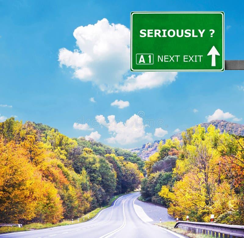 SERIAMENTE sinal de estrada contra o céu azul claro imagem de stock royalty free