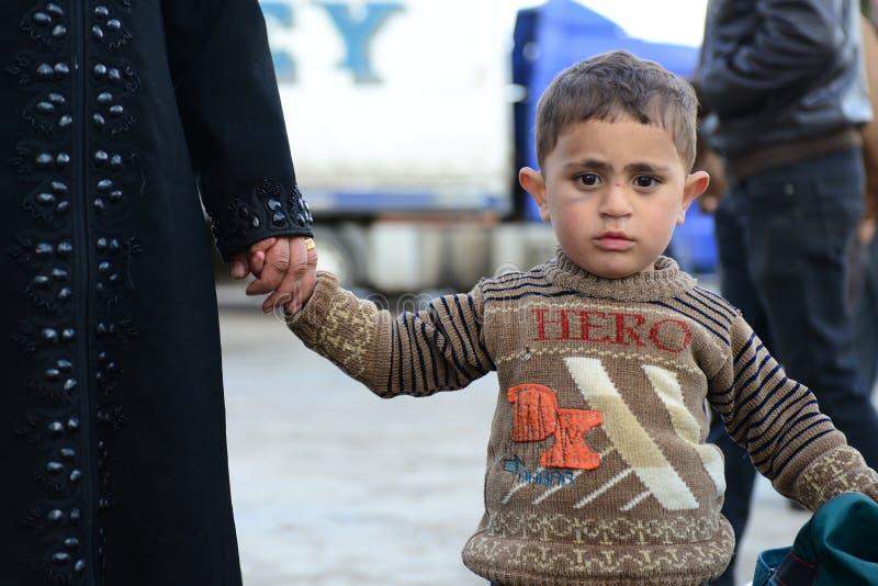 Serie de retratos de los refugiados del sirio de los niños imagenes de archivo