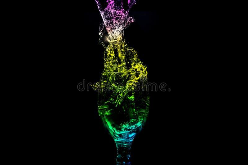 Serie del chapoteo del agua - Mini Wine Glass Turbulent Color imagen de archivo libre de regalías