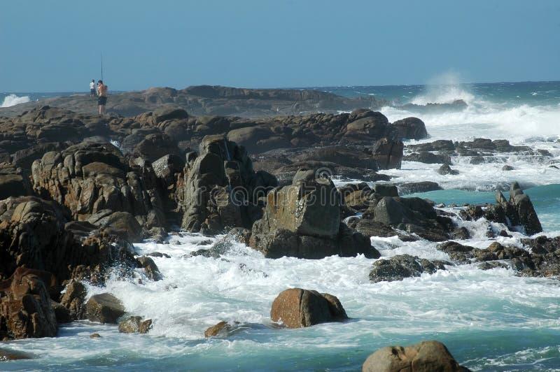 Serie della spiaggia: Pescando sulla R fotografia stock