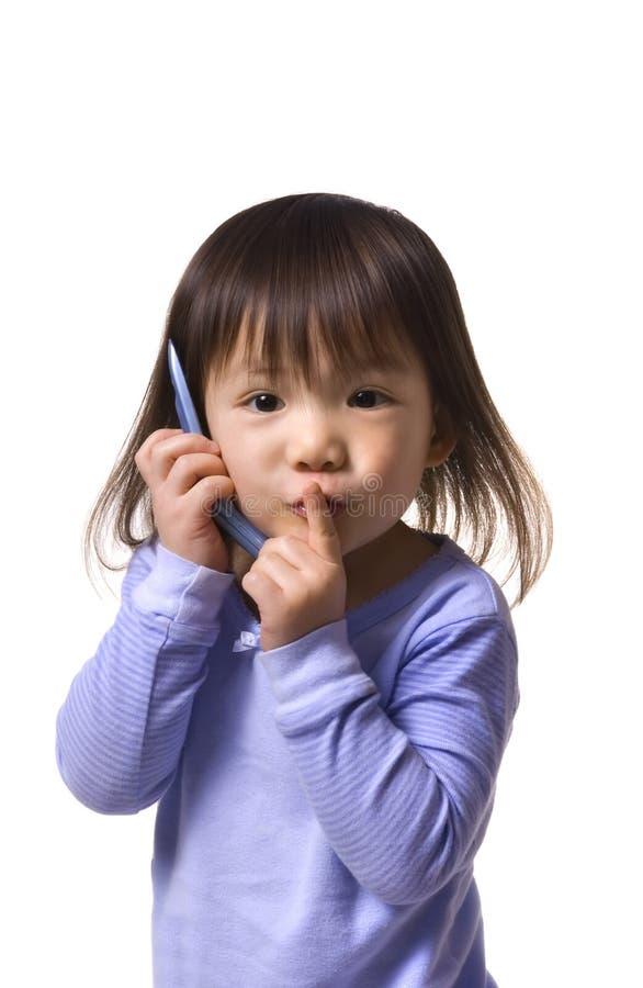 Serie di infanzia (abbastanza sono sul telefono) fotografia stock libera da diritti