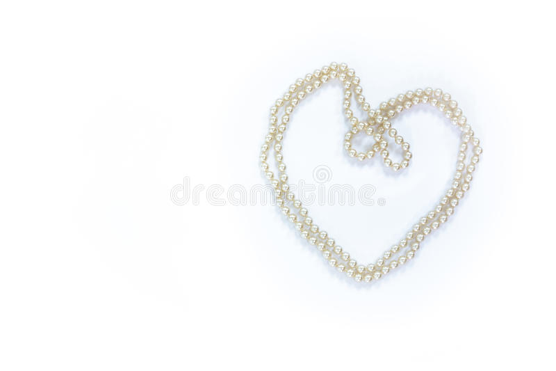 Serie di perle a forma di come cuore fotografia stock