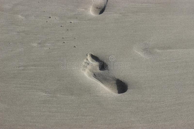 a series of bare footprints on the Baltic coast. stock image