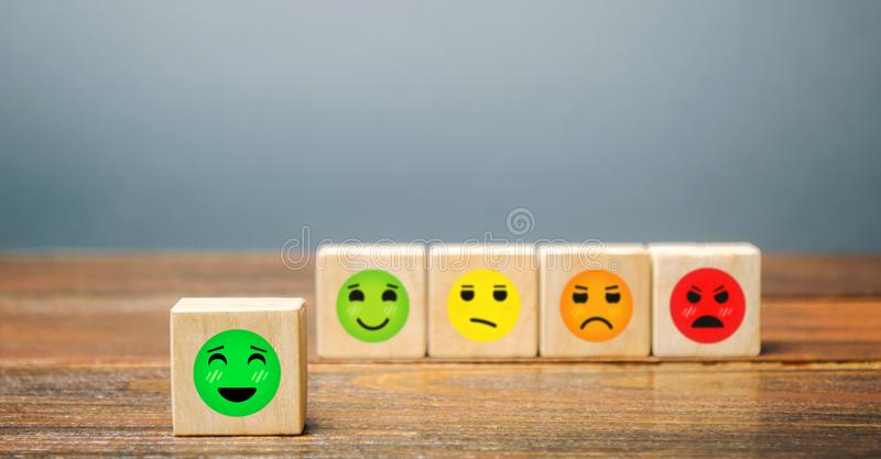A series of blocks with faces from happy to angry. Happiness face selected. Concept of good rating, review and feedback. Satisfied. Customers and positive stock images