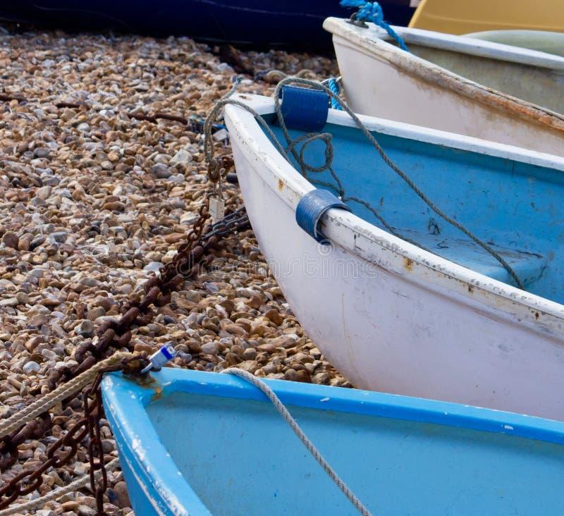 Series of boat Bows, mooredon shingle. Series of 3 boat bows , moored on shingle stock photo
