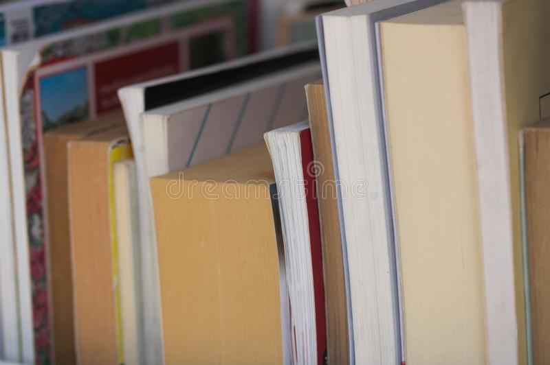 A series of books viewed from the side stock images