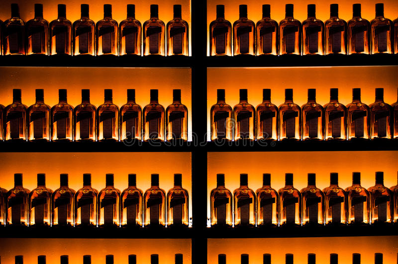 Series of bottles against the wall royalty free stock photo