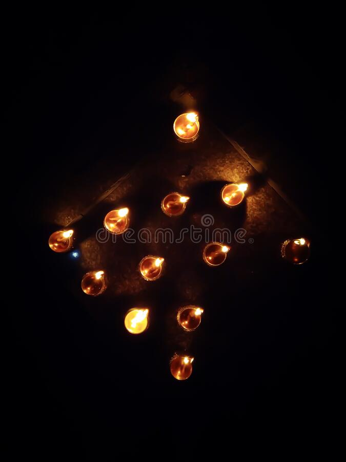 Series of Diya  small lamp lit by oil and thread stock photos