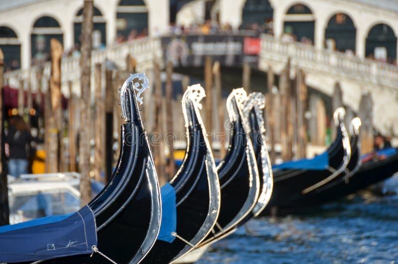 Gondolas in Venice near the Rialto bridge stock photo