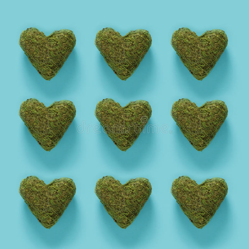 Series of green moss hearts on blue. Series of green moss hearts on a blue background royalty free stock photo