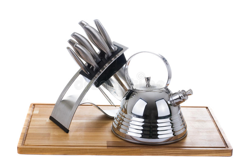 Series of images of kitchen ware. Teapot and knife royalty free stock photos