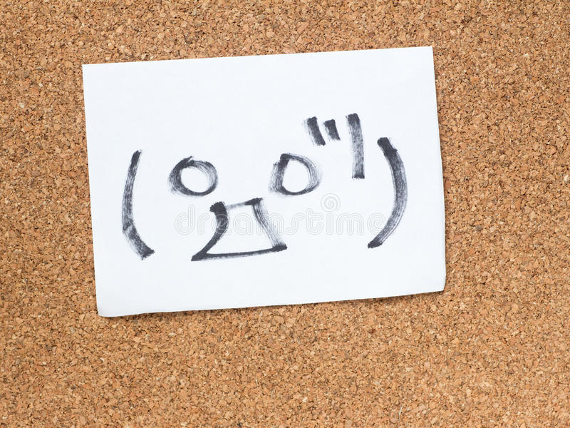 The series of Japanese emoticons called Kaomoji, surprised. The series of Japanese emoticons called Kaomoji on the cork board, surprise royalty free stock photography