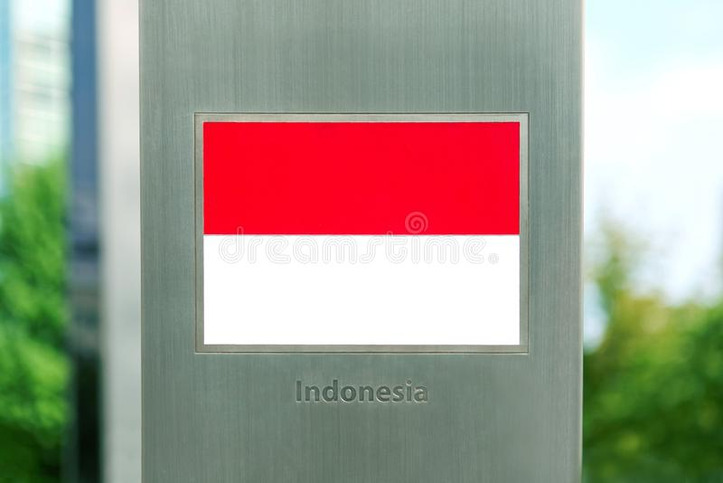 Series of national flags on metal pole - Indonesia royalty free stock photos