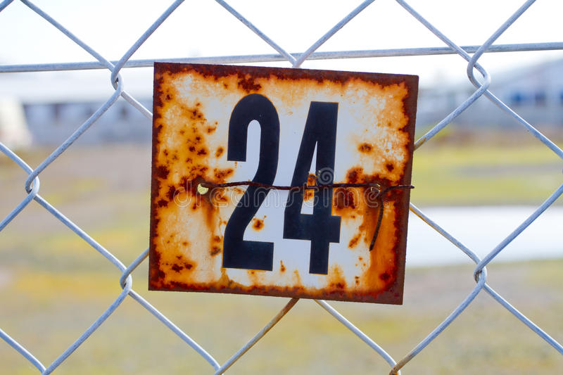 Number 24 Rusted Sign stock photography