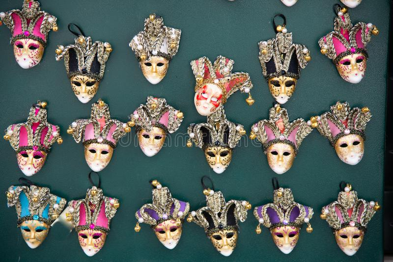 Series of small painted carnival Venetian masks. royalty free stock photo