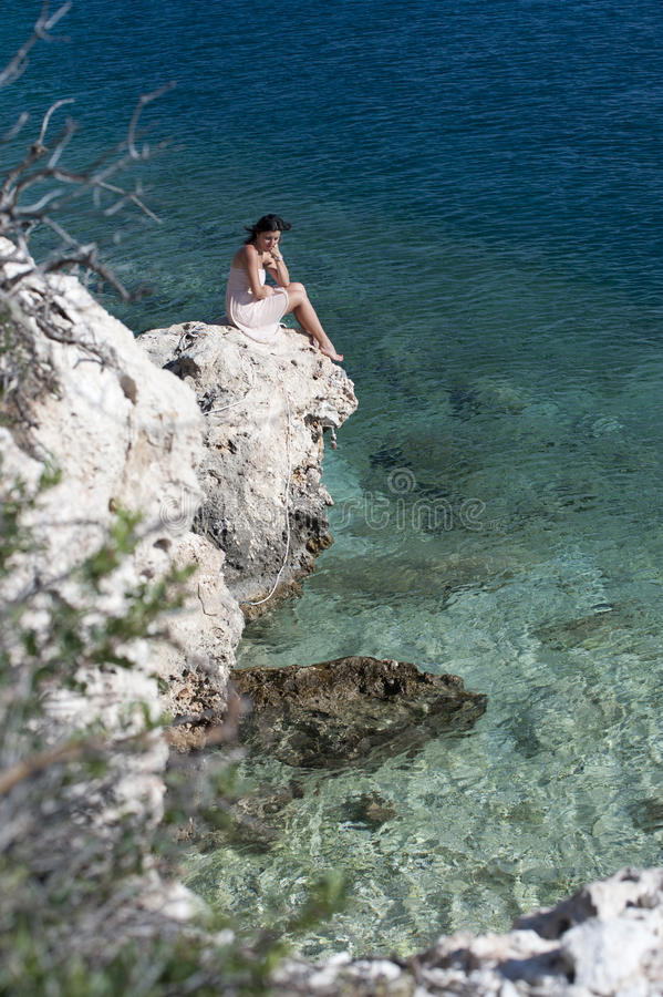 Series of a women on a rock royalty free stock photo