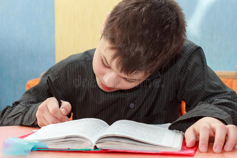 Serios boy doing lessons stock photography