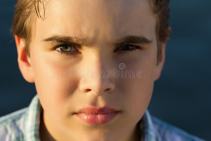 Serious. Handsome boy with a serious face stock image