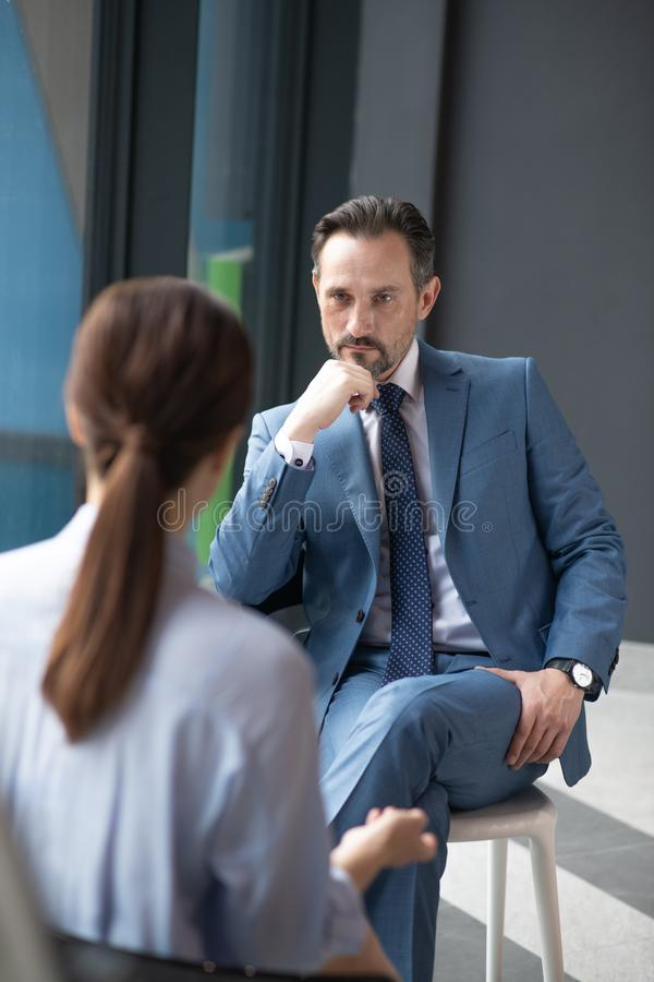 Free Serious Affluent Businessman Listening To Journalist Asking Him Questions Royalty Free Stock Photography - 164520367