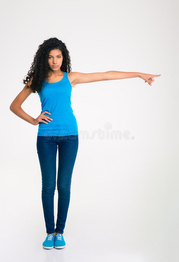 Serious afro american woman pointing finger away stock images