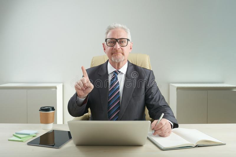 Serious Aged Entrepreneur Posing for Photography stock photo