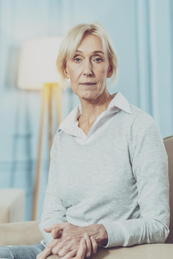 Serious aged woman looking at you royalty free stock images