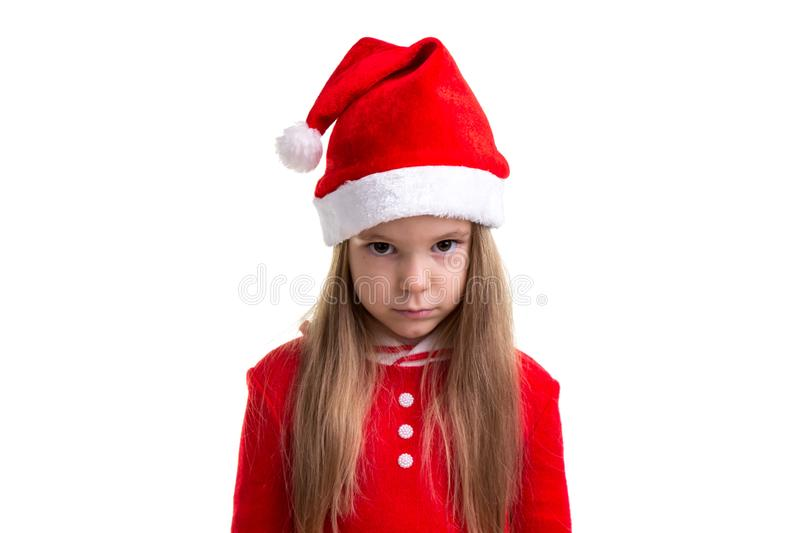 Serious and angry christmas girl wearing a santa hat isolated over a white background stock photos