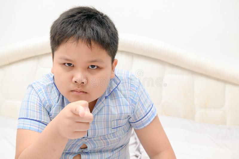Serious or angry obses kid points index finger royalty free stock photo