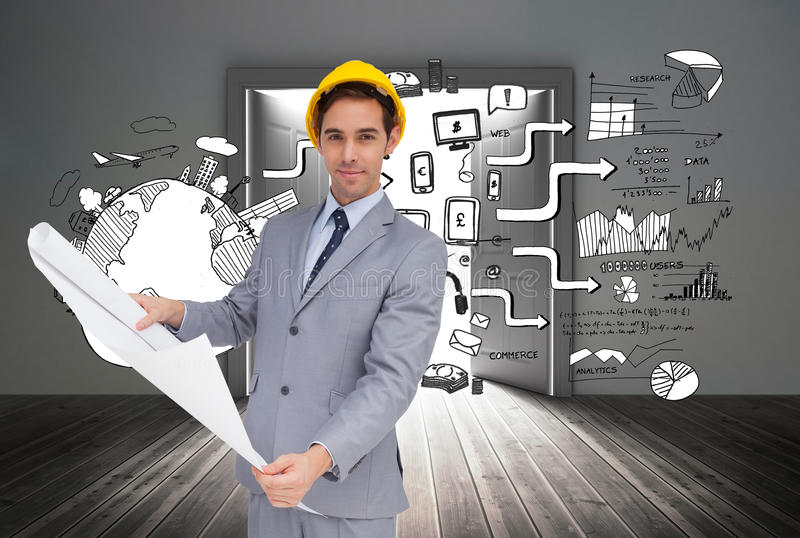 Serious architect with hard hat holding plans. Composite image of serious architect with hard hat holding plans stock image