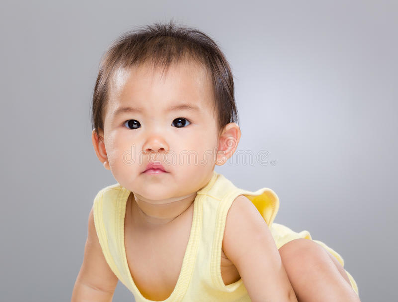 Serious asian baby girl stock images