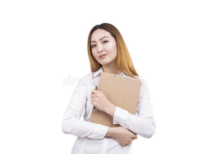 Serious Asian woman with clipboard and pen stock images