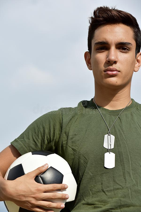 Serious Athletic Hispanic Male Teen Soldier royalty free stock photo