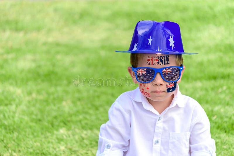 Serious Australian boy on Australia Day stock images