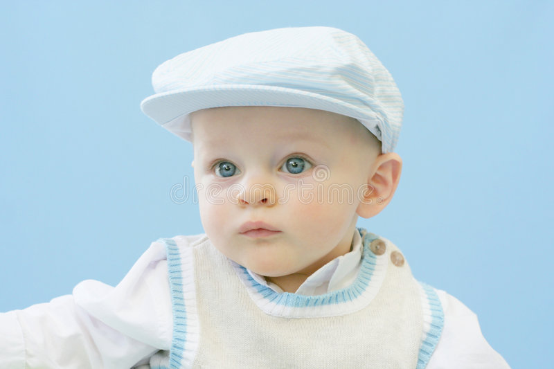 Serious Baby. Boy dressed up in golfer hat and vest