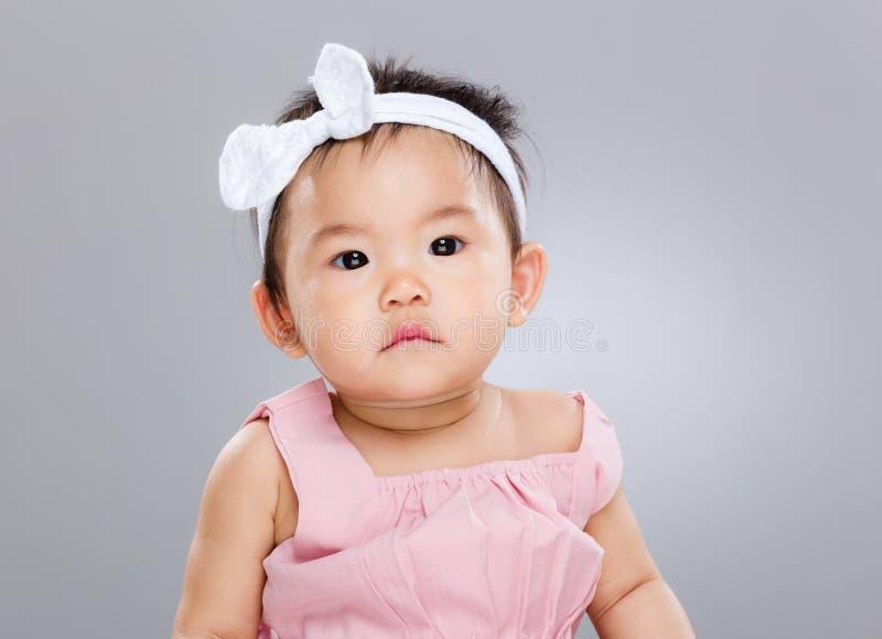 Serious baby girl stock photo