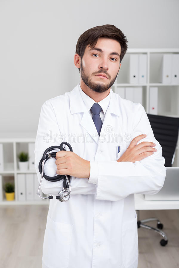 Serious bearded doctor royalty free stock photography