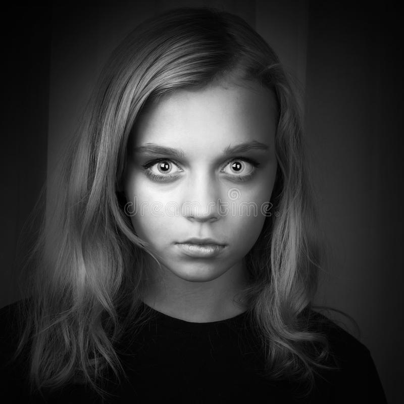 Serious blond Caucasian girl with mysterious look. Serious blond Caucasian girl with mysterious hypnotic look stock image