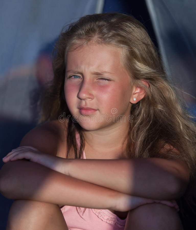 Serious blond girl on vacation royalty free stock photos