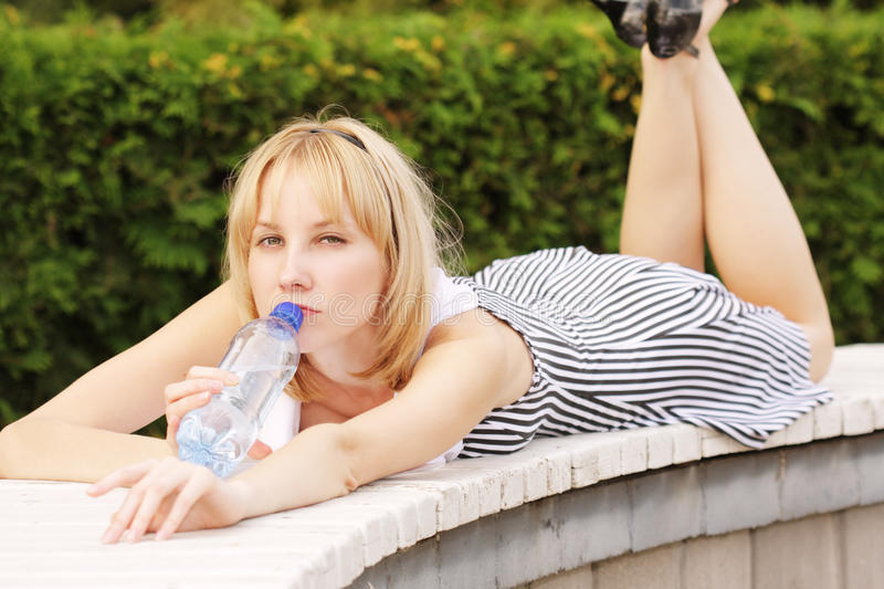 Download Serious Blonde With Bottle Of Water Royalty Free Stock Image - Image: 11980546