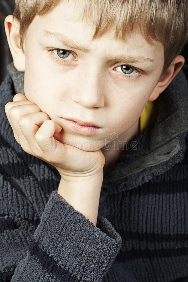 Download Serious blonde child stock photo. Image of blue, stressed - 18085302