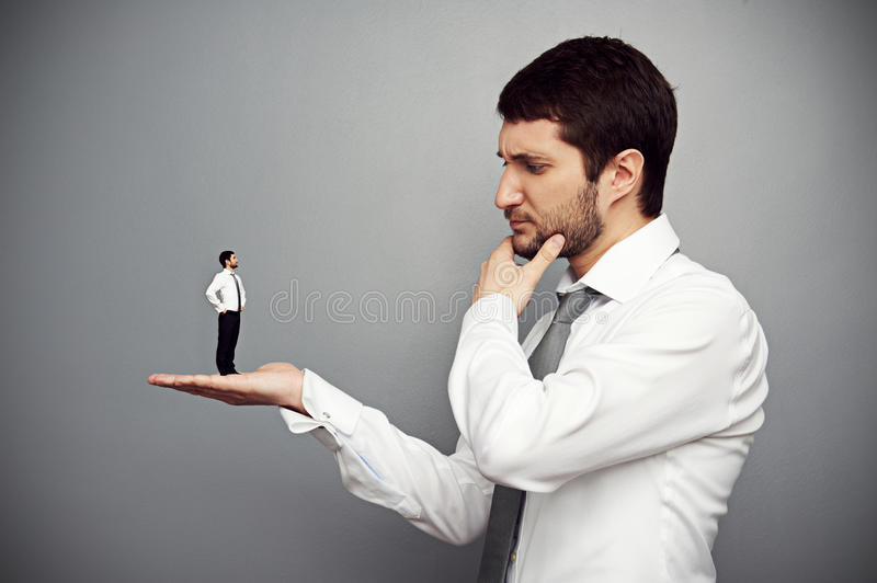 Serious boss considering the employer royalty free stock photos